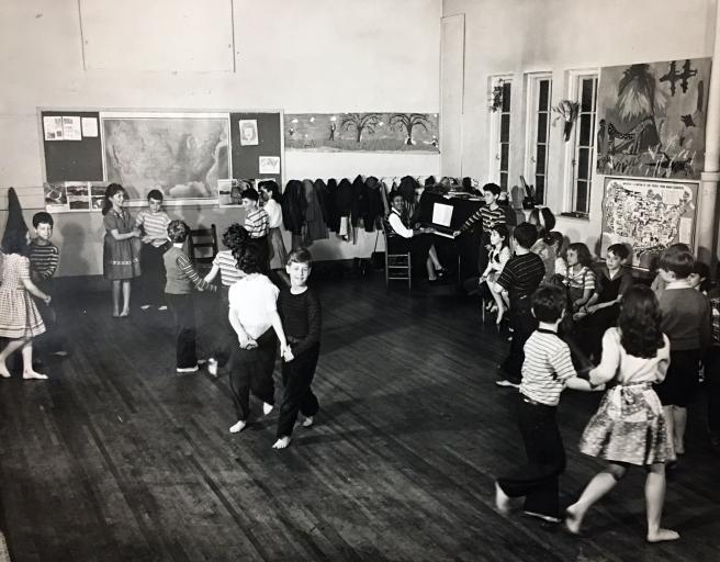 Folk dancing, the Eights with teacher Mabel Hawkins, ca. 1955 Students: Bobby Straus, Linda White, Joan Matthews, Hank Lifson, Stephen Kappell, Emily Pinado, John Baer, Michael Fields, Bobby Schneck